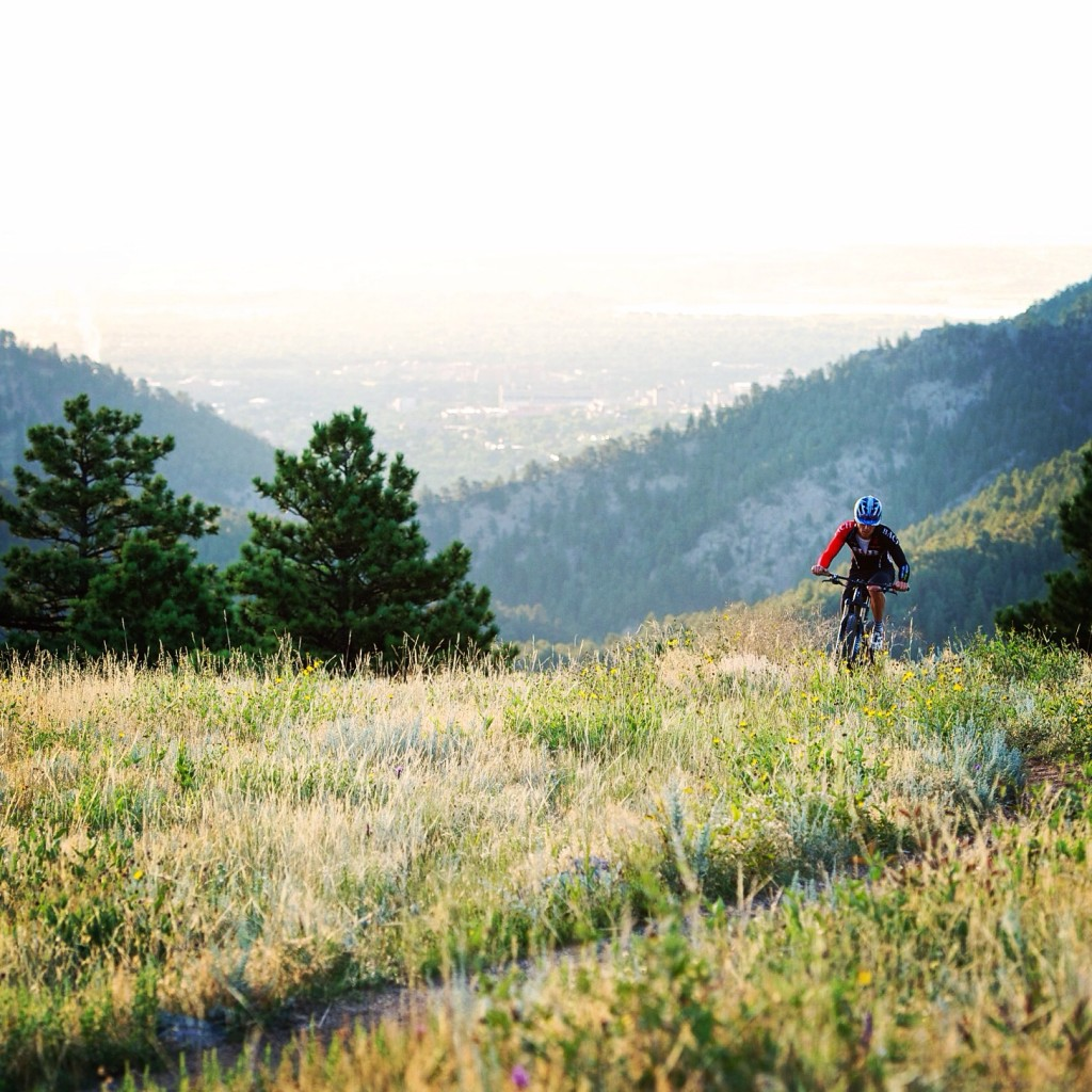 A rider mountain bikes at Betasso at sunrise, shot on assignment for the NY Times